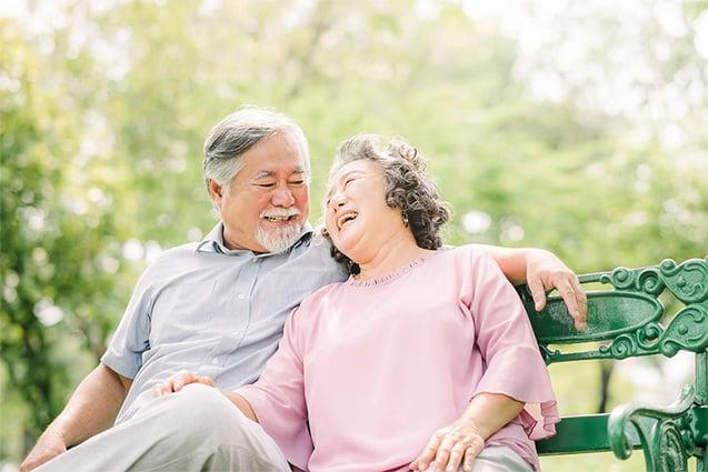 Happy-Asian-Senior-Couple-Laughing